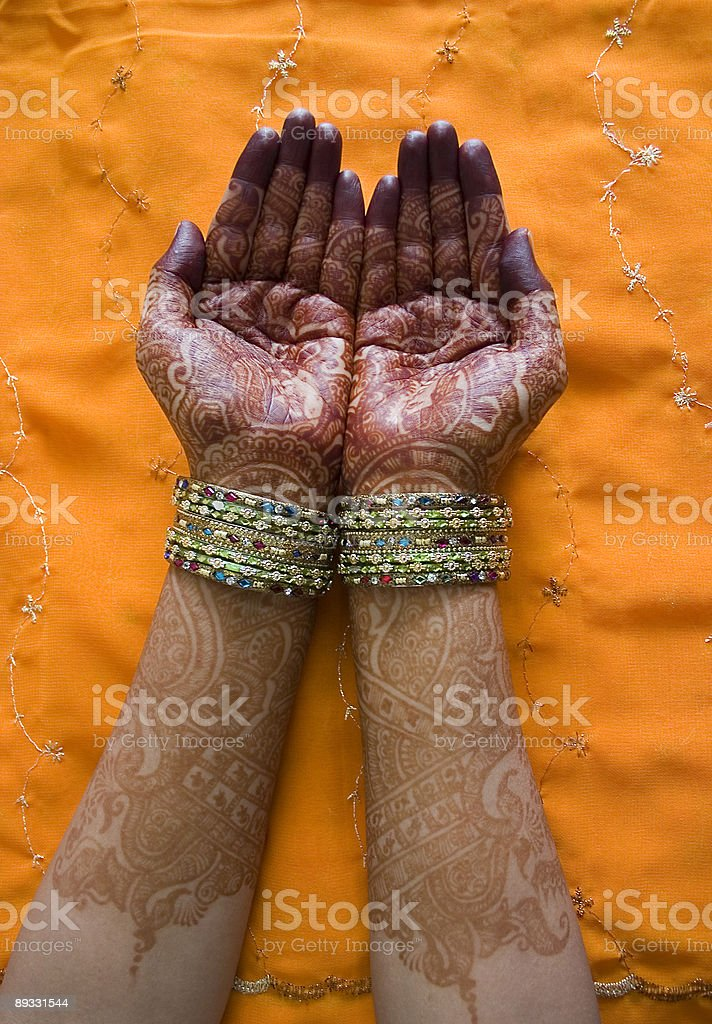 Hands of a Indian bride with henna design and bangles. royalty-free stock photo