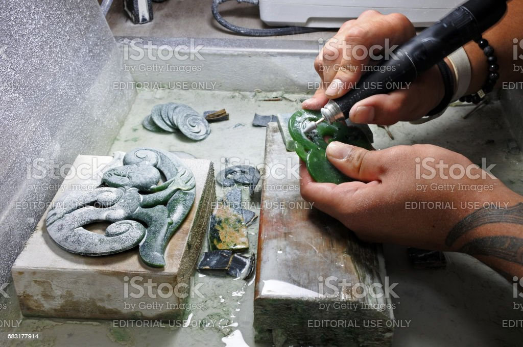 Hands of a Jade ornamental green rock carver at work. New Zealand...
