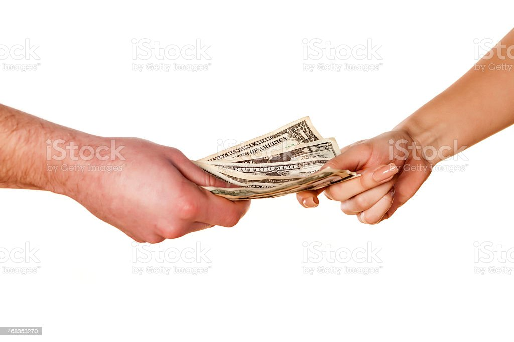 Hands of a man and a woman holding onto money stock photo