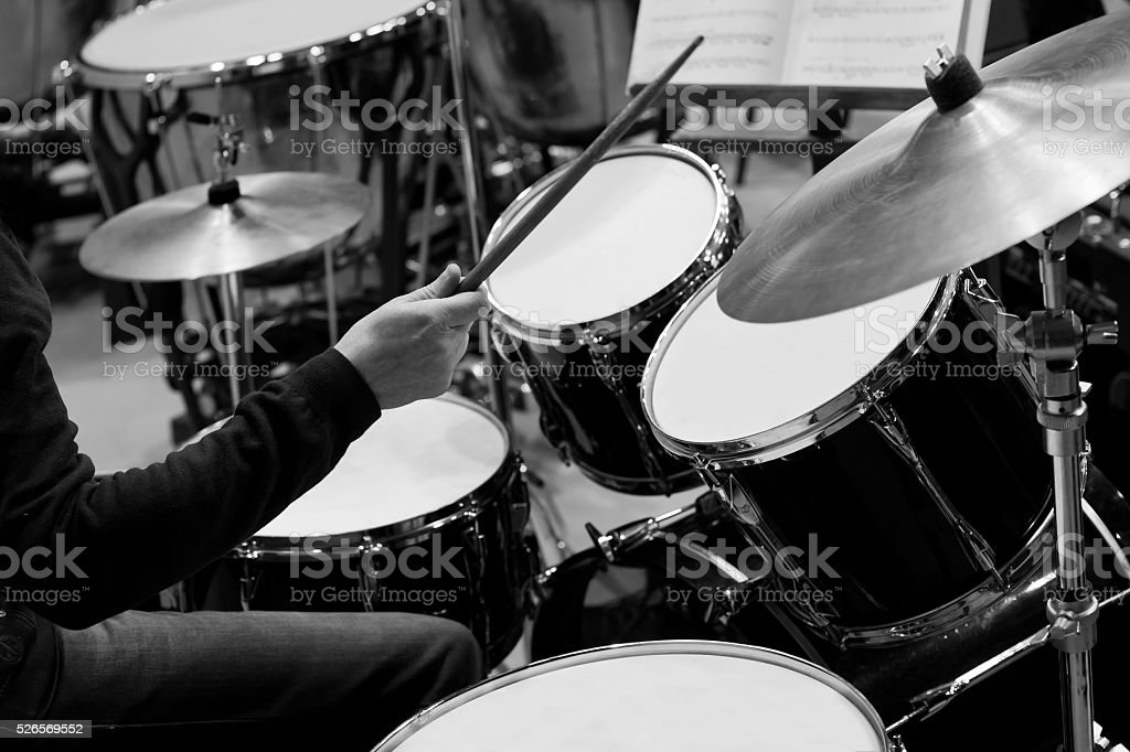Hands of a man playing a drum kit stock photo
