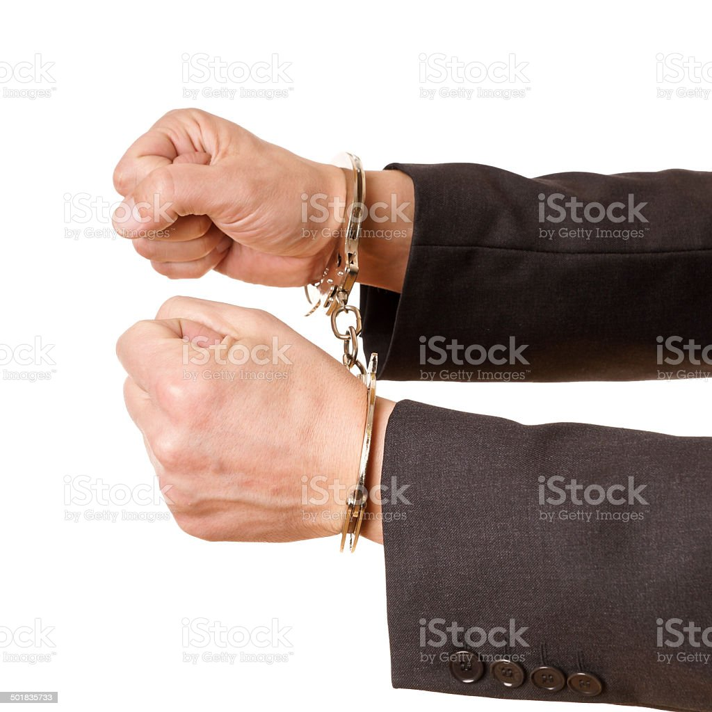 hands of a man with handcuffs stock photo