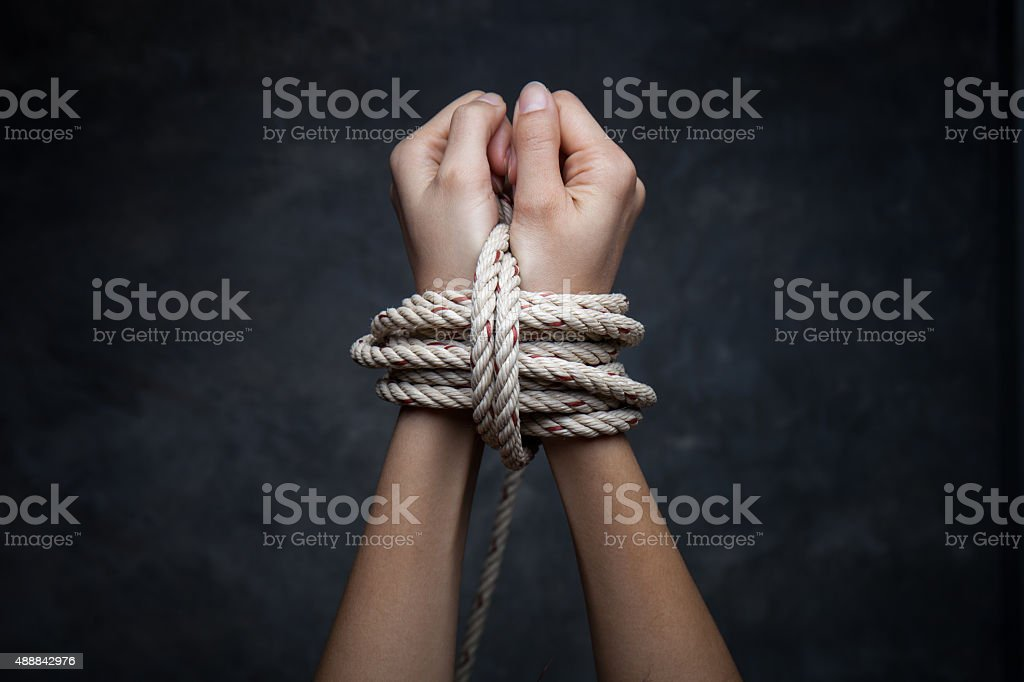 Hands of a missing kidnapped, abused, hostage, victim woman stock photo