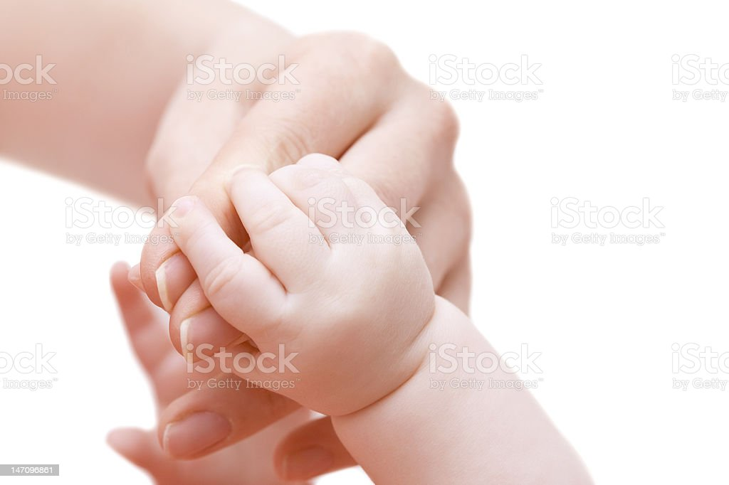 Hands of a mother and her baby royalty-free stock photo