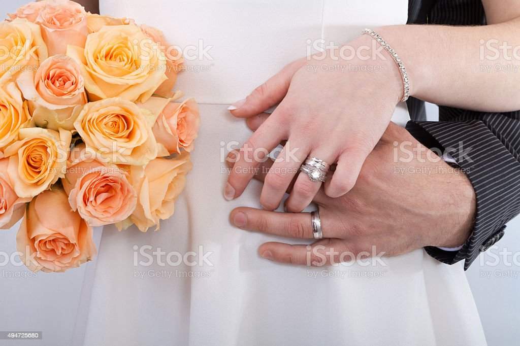 Hands of a newlywed couple stock photo