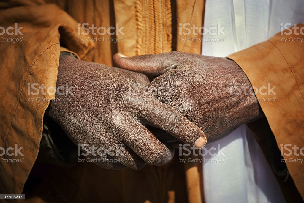 Hands of a nomad in the desert royalty-free stock photo