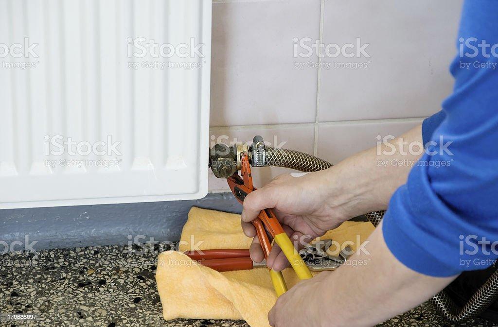 hands of a plumber repairman stock photo