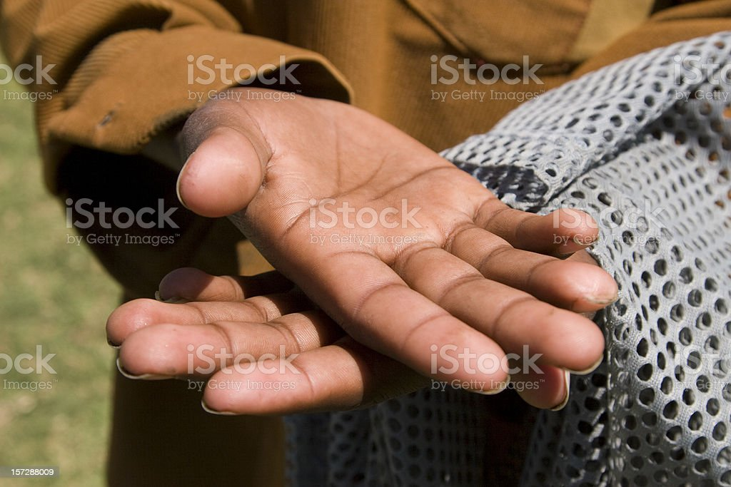Hands of a poor boy royalty-free stock photo