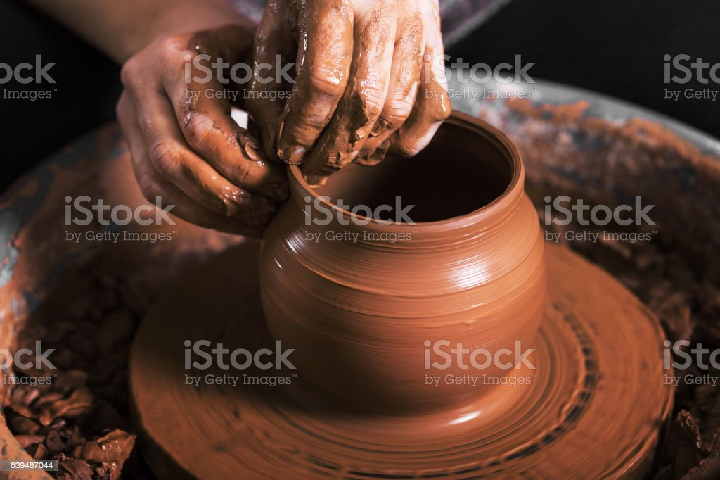 hands of a potter, creating an earthen jar stock photo