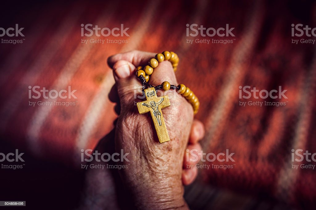 Hands of a Senior Woman Praying stock photo