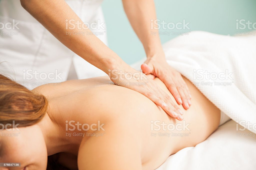 Hands of a therapist giving massage stock photo