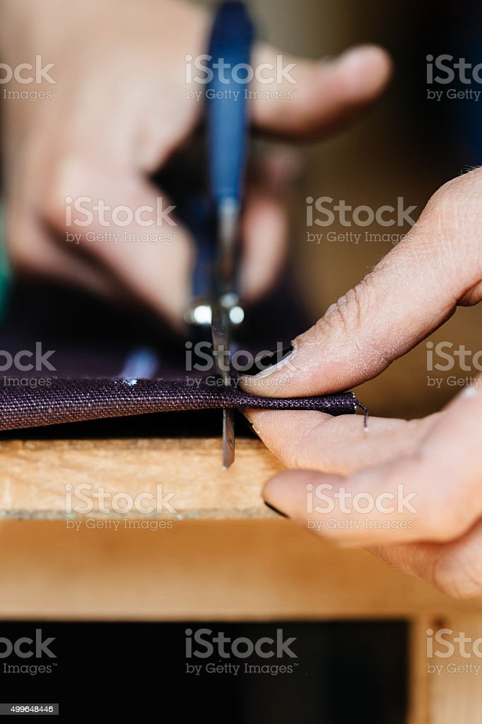 Hands of a woman cutting fabrics stock photo