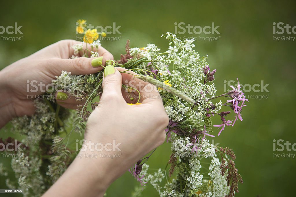 Hands of a woman doing garland royalty-free stock photo