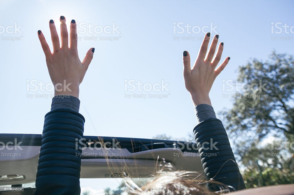 Hands of a woman during a travel in a car stock photo