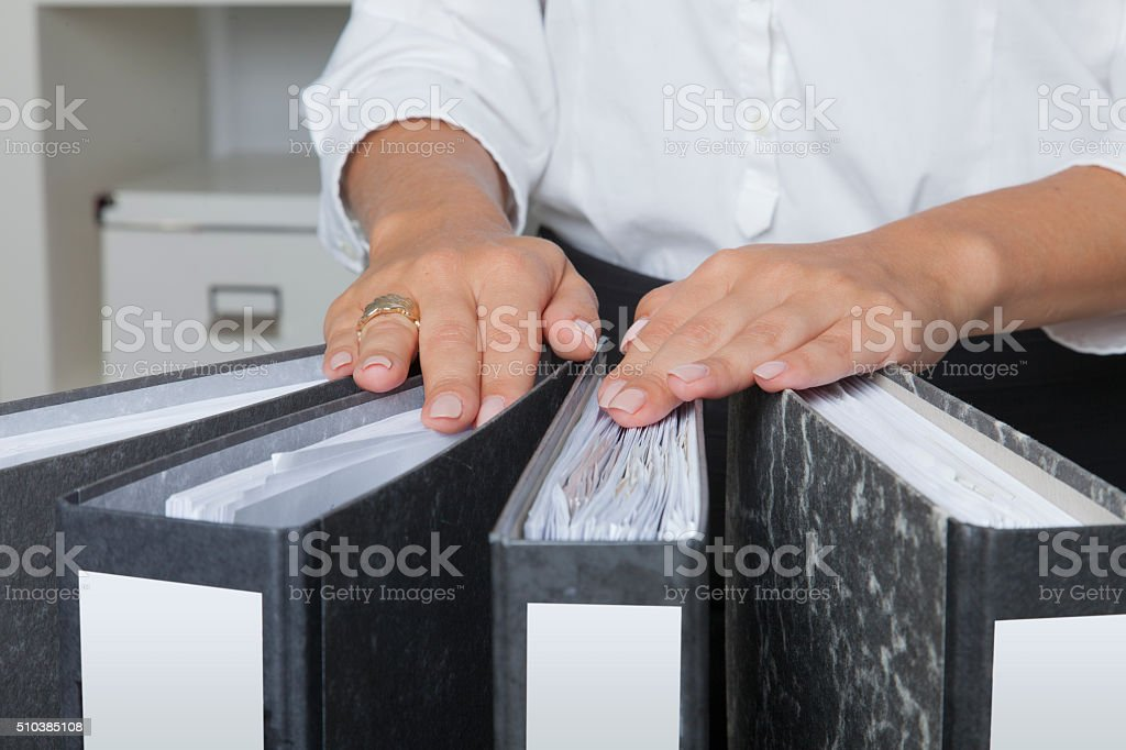 Hands of a woman on office files stock photo