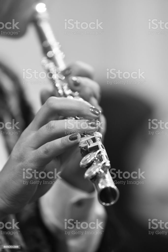 Hands of a woman playing the flute stock photo