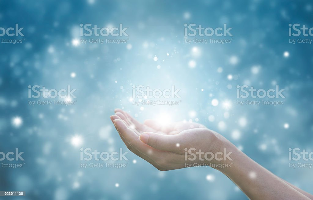 Hands of a woman respecting and praying on blue background stock photo