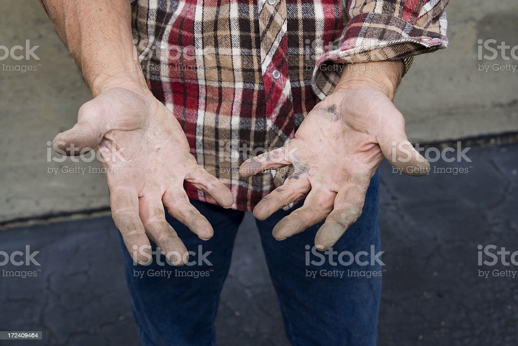 Hands of a working man stock photo