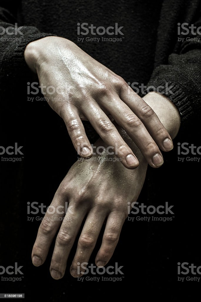 Hands of a young woman isolated on dark background stock photo