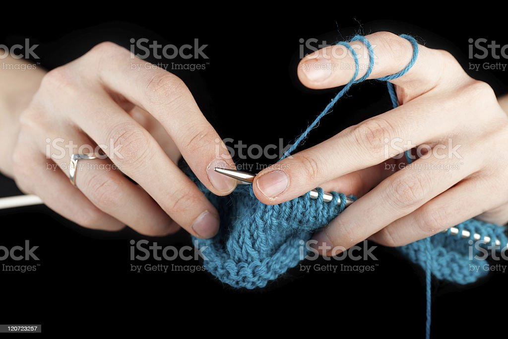 Hands of a young woman knitting royalty-free stock photo
