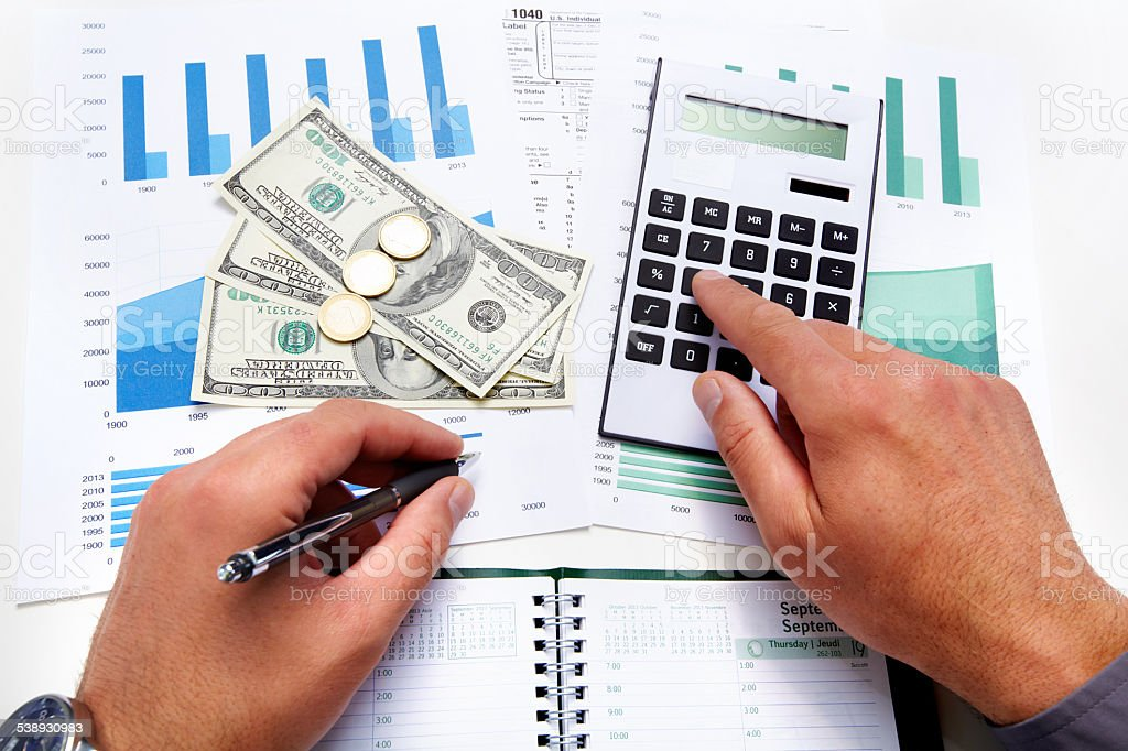 Hands of accountant business man with calculator. Accounting stock photo