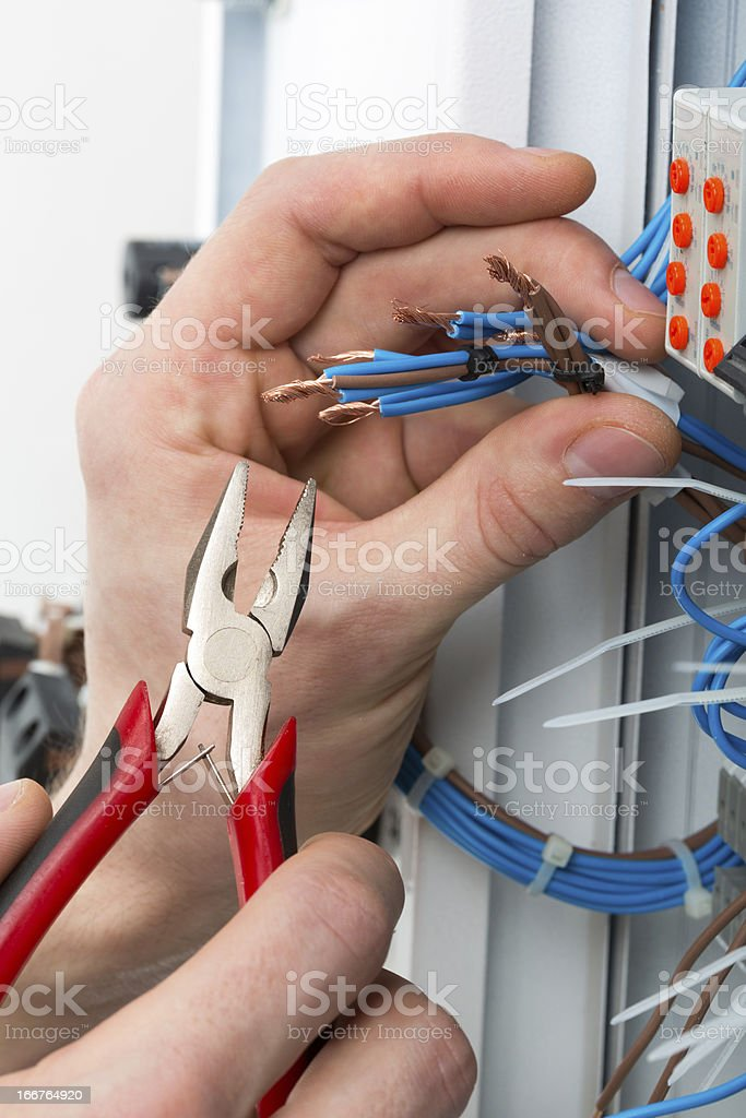 Hands of an electrician stock photo