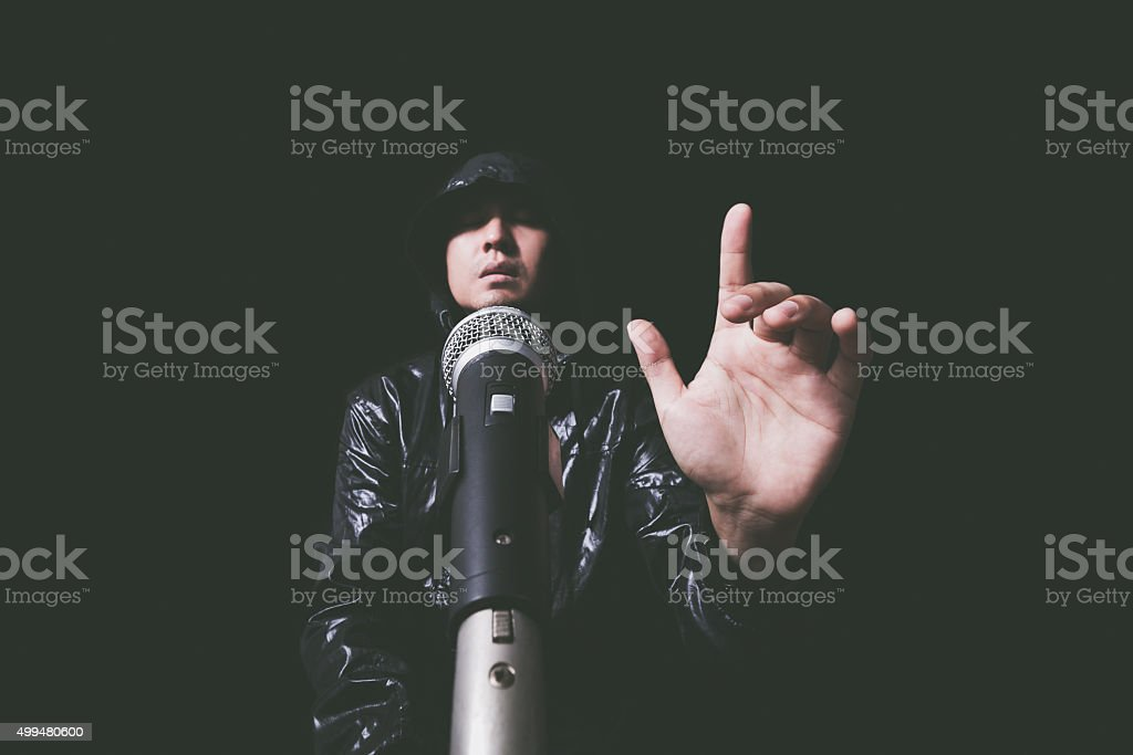 hands of asian handsome singer dynamic microphone stock photo