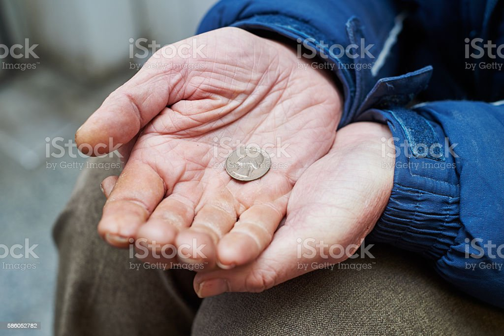 hands of beggar with us cent coin begging for money stock photo
