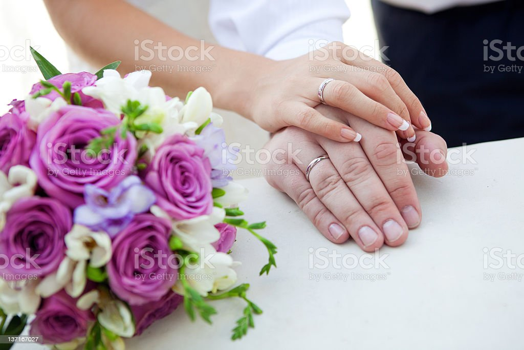 hands of bride and groom royalty-free stock photo
