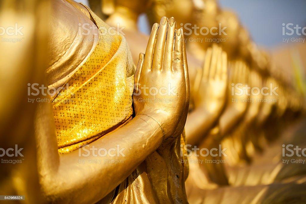 Hands of buddha statue stock photo