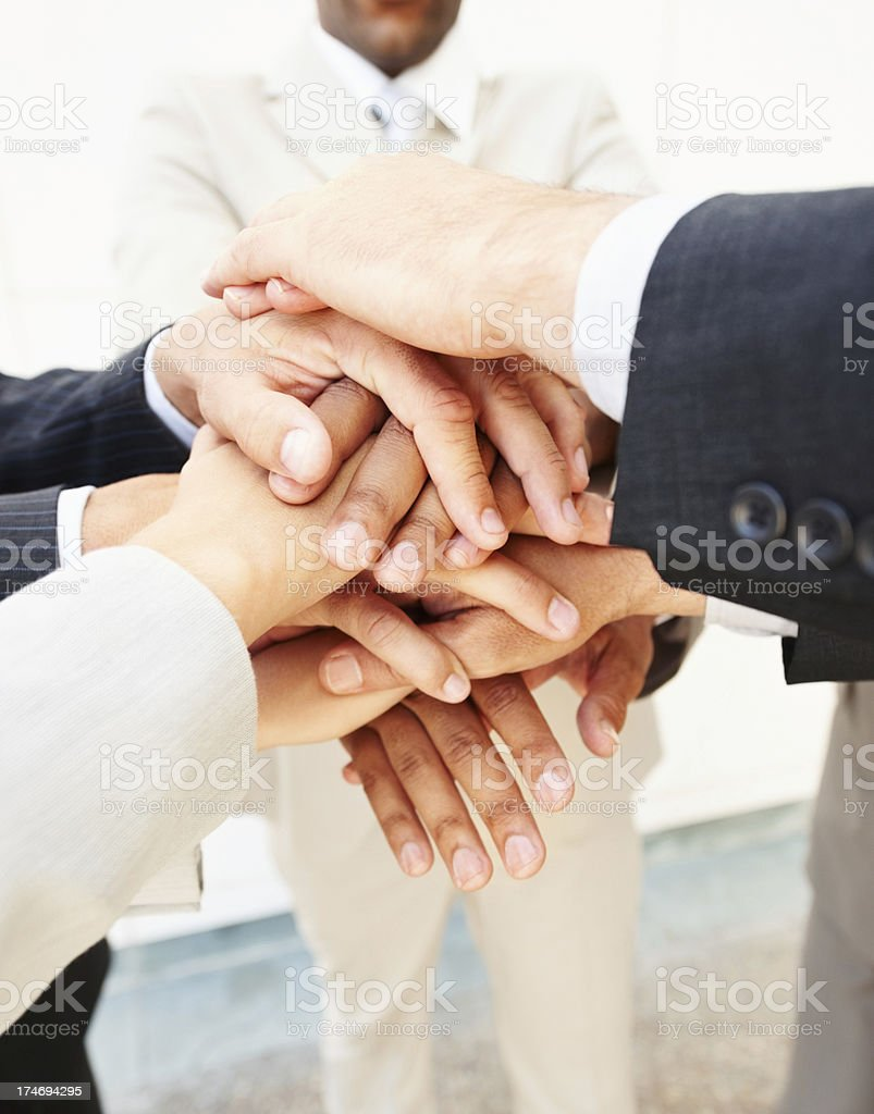 Hands of business people kept one over other royalty-free stock photo