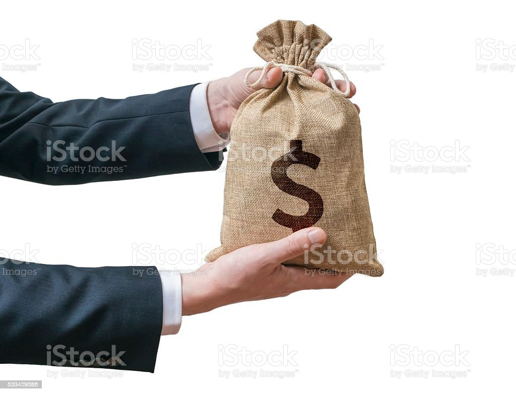 Hands of businessman holds bag full of money. stock photo