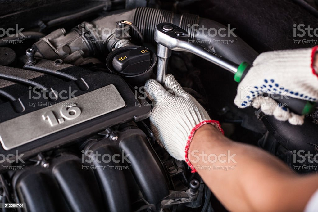 Hands of car mechanic stock photo