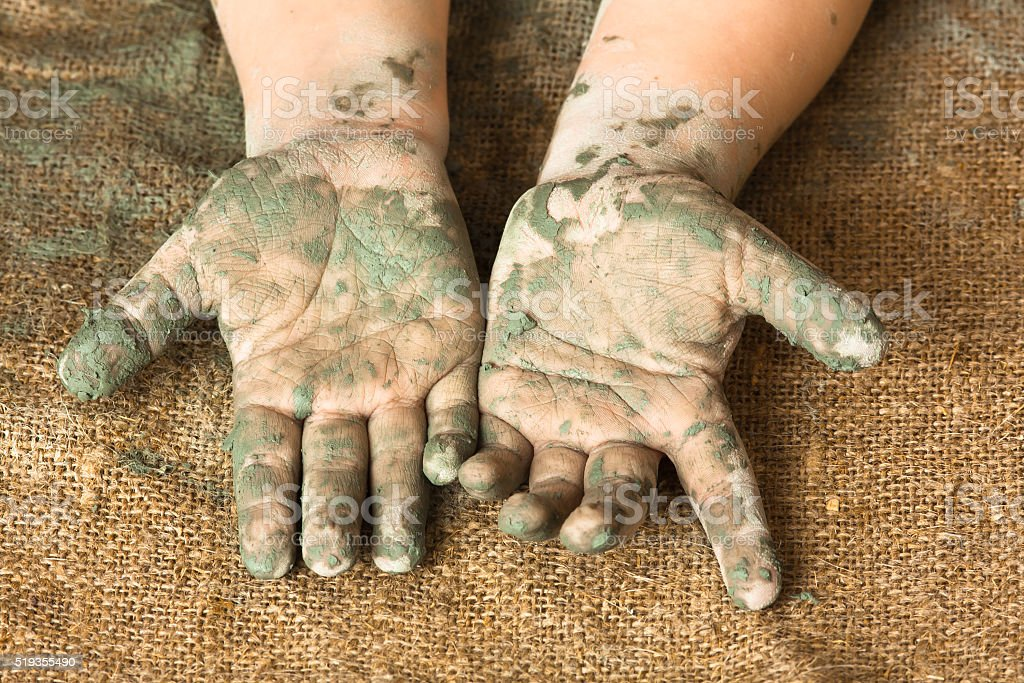 hands of child after working with clay stock photo