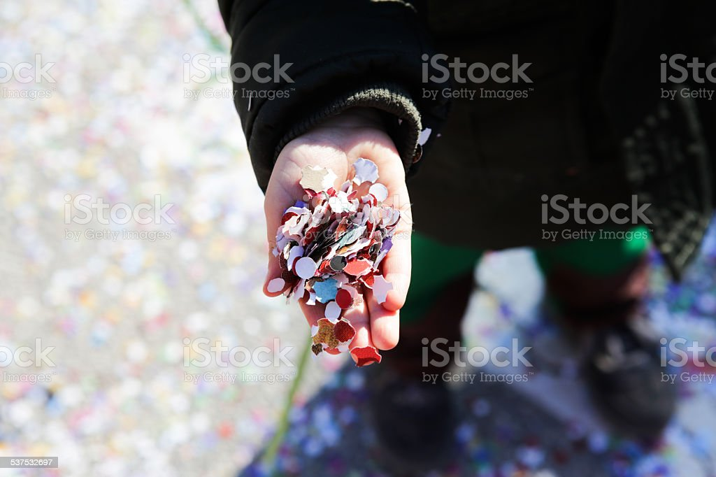 Hands of children holding confetti royalty-free stock photo