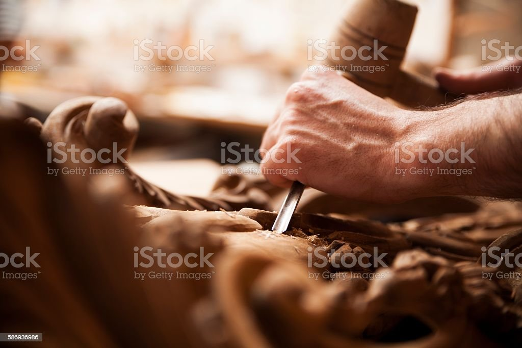 Hands of craftsman carve  with a gouge stock photo