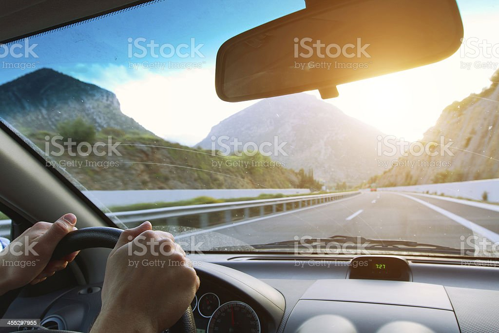 hands of driver on the steering wheel stock photo
