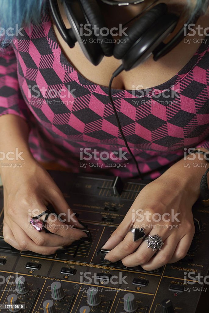 Hands of female DJ mixing music stock photo
