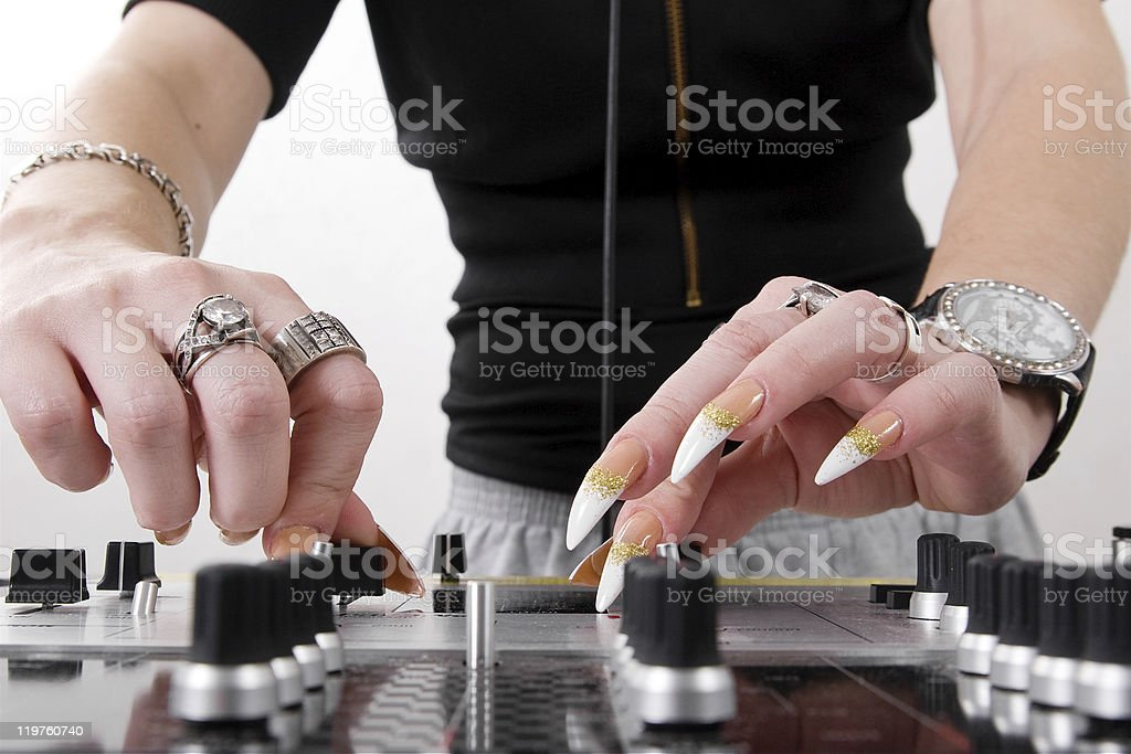 Hands of female DJ playing stock photo