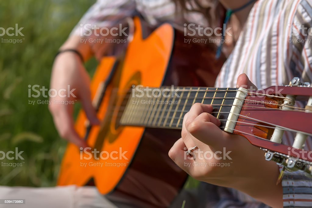 Hands of female Musician playing Gu stock photo
