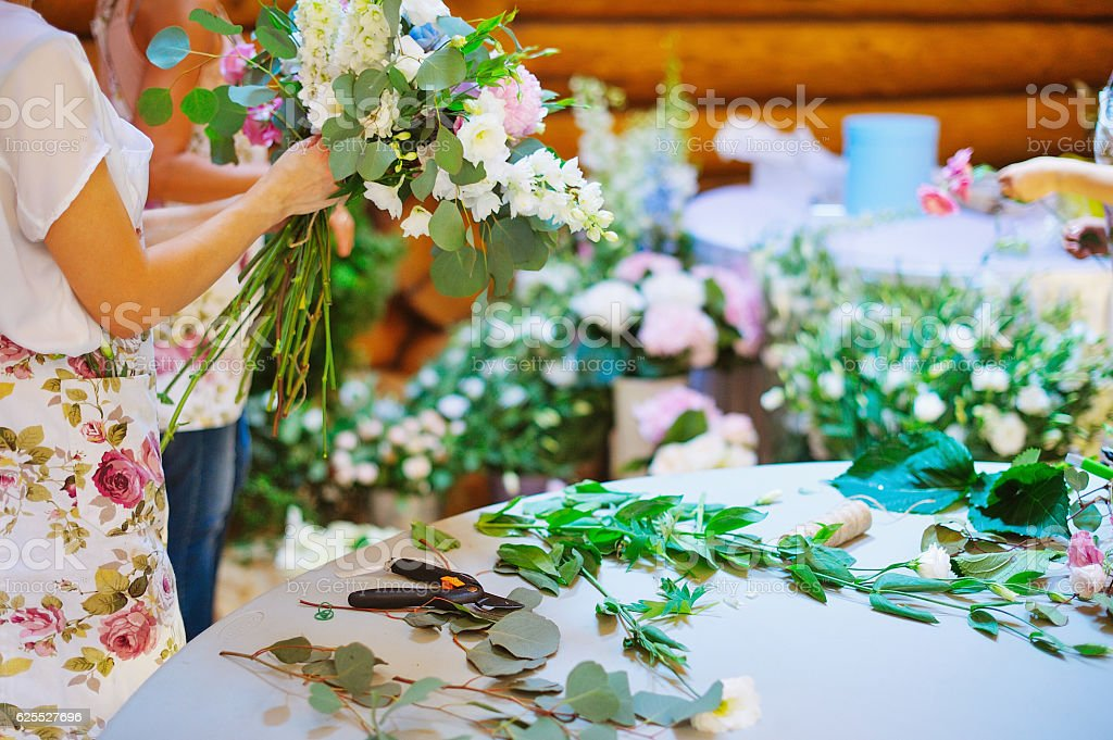 Hands of florist woman creating bouquets stock photo