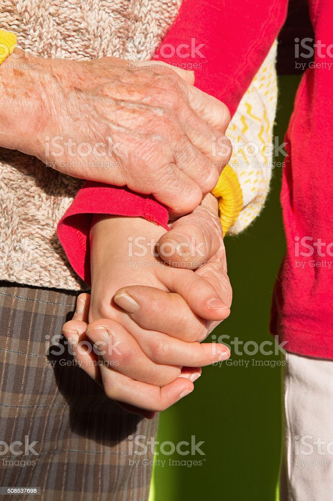 hands of grandmother and grandchild stock photo