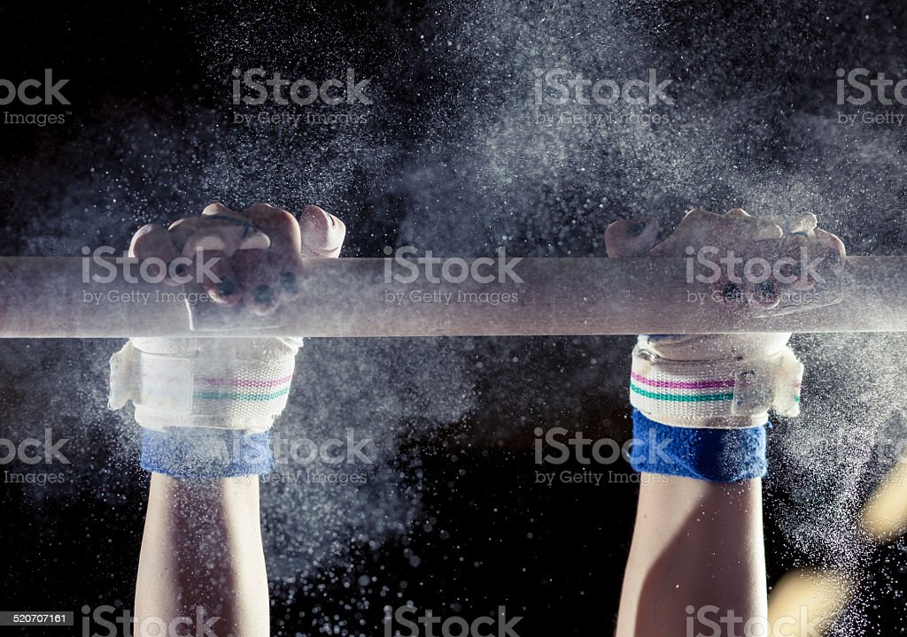 hands of gymnast with chalk on bars stock photo