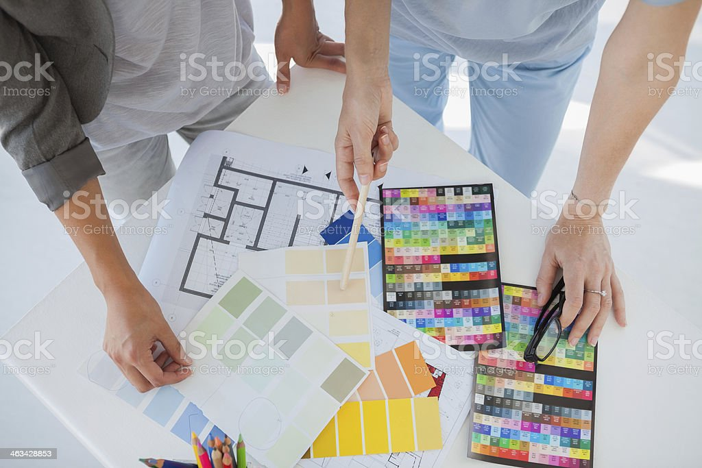 Hands of interior designers working on colour samples royalty-free stock photo