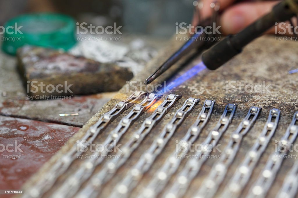 hands of jeweller at work silver soldering royalty-free stock photo