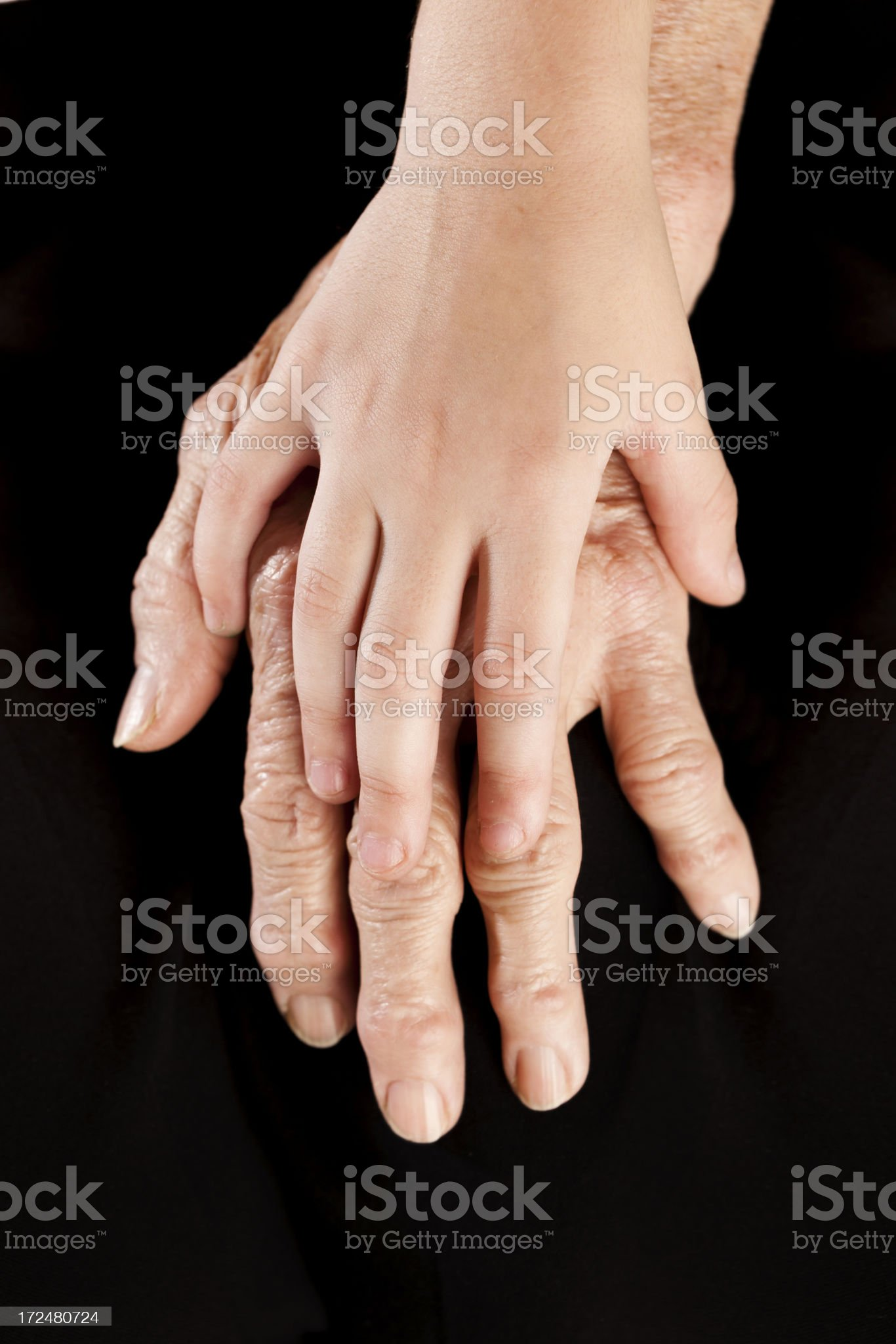 Hands of little girl and grandma royalty-free stock photo