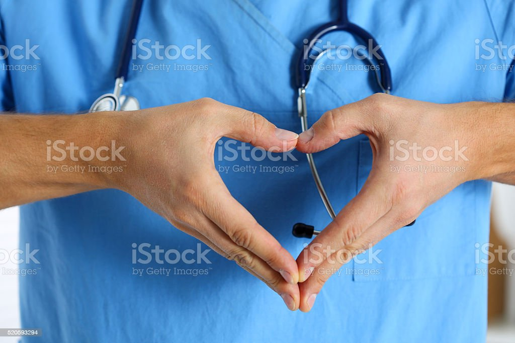 Hands of male medicine therapeutist doctor wearing blue uniform stock photo