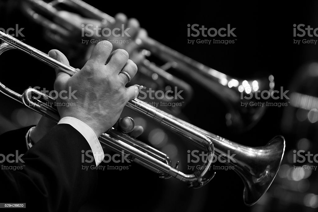 Hands of man playing the trumpet in the orchestra stock photo