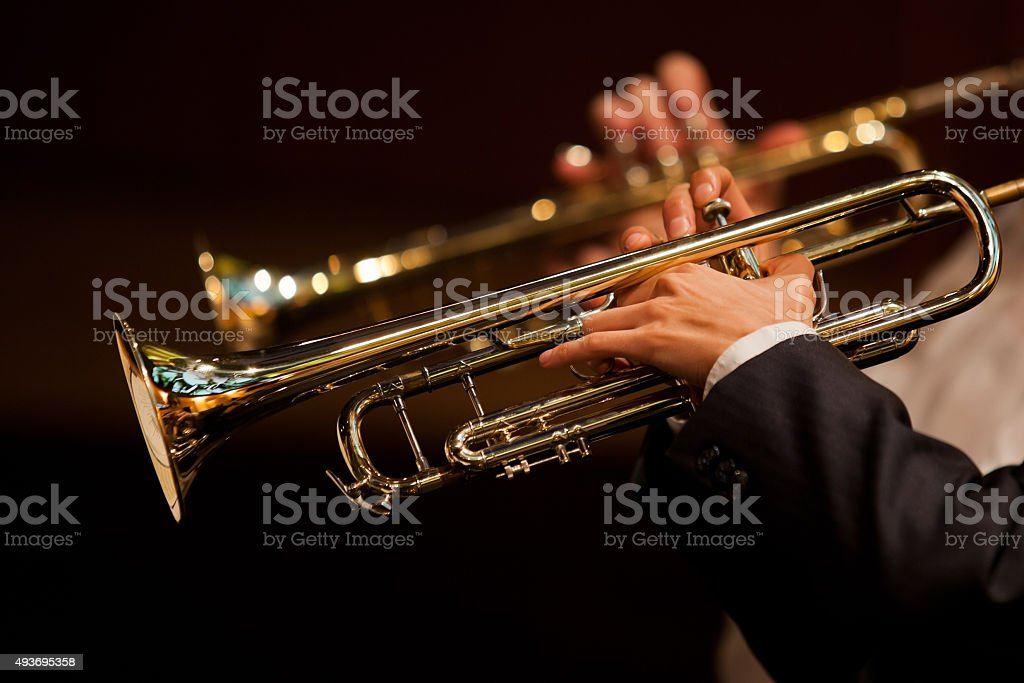 Hands of man playing the trumpet stock photo