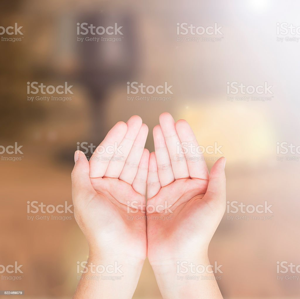 Hands of man praying stock photo