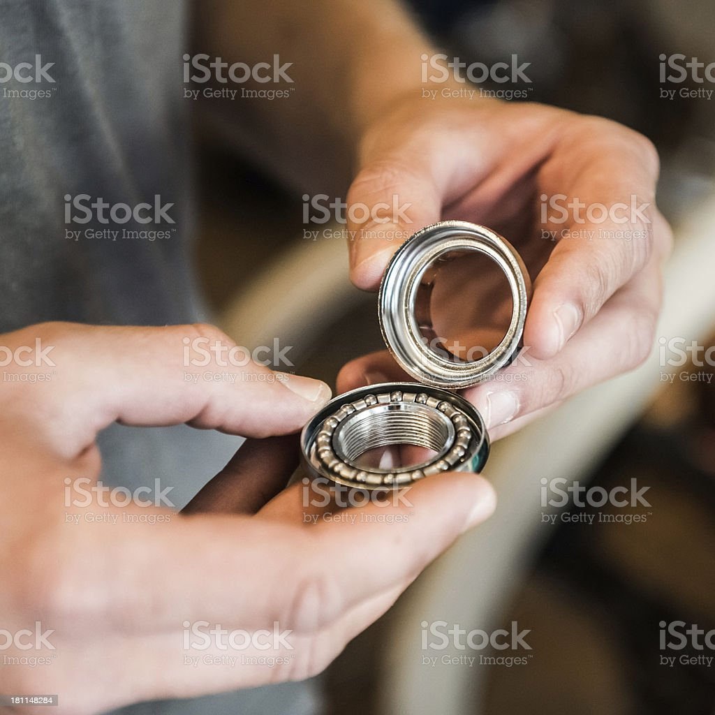 Hands Of Mechanic Holding An Open Ball Bearing royalty-free stock photo